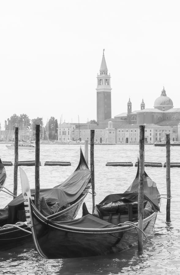 Two gondolas moored stock photos