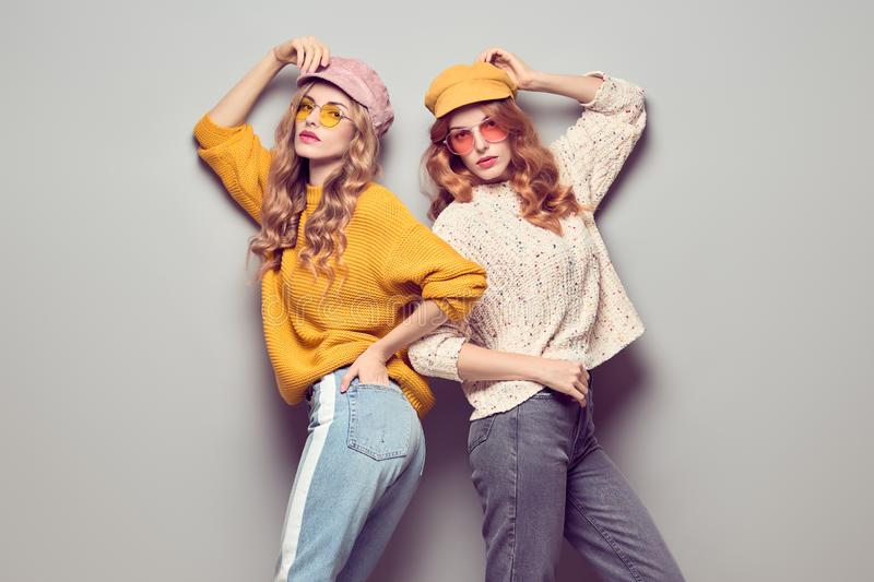 Two Gorgeous Girl Friends in Fashion Autumn Outfit stock photography