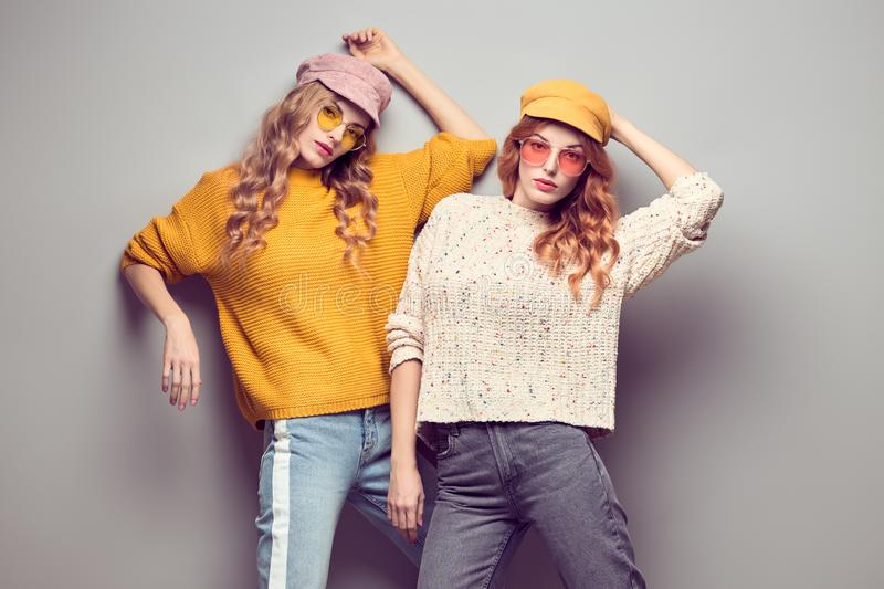 Two Gorgeous Girl Friends in Fashion Autumn Outfit stock images