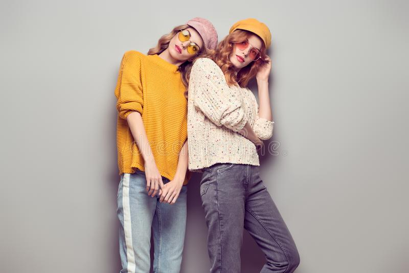 Two Gorgeous Girl Friends in Fashion Autumn Outfit royalty free stock photo