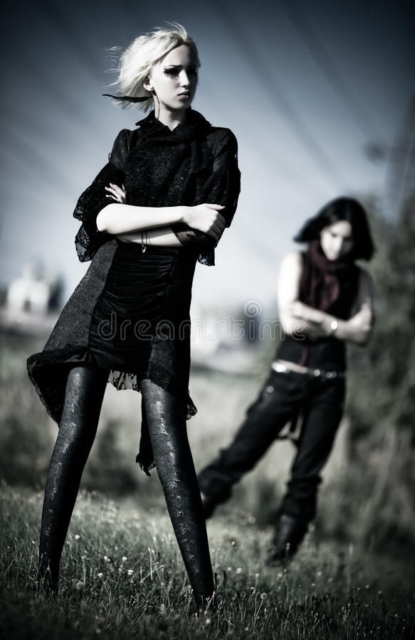 Two goth women outdoors stock photos