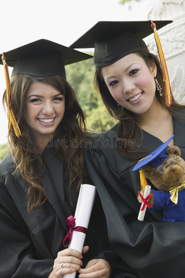 Free Two Graduates Holding Diploma And Teddy Bear Portrait Stock Photos - 30841273