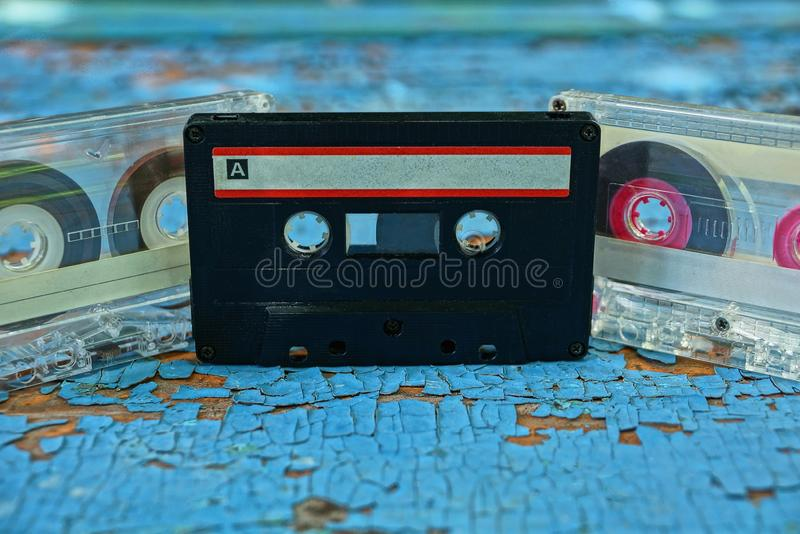 Gray and black old audiotapes are on the blue board royalty free stock photos