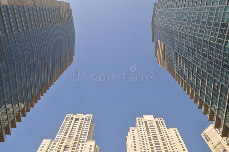 Two Gray-and-blue Glass Buildings royalty free stock photo
