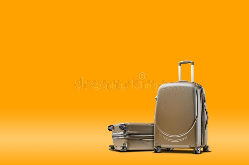Two gray suitcases are standing against an orange background. A realistic shadow is drawn in under them. Collage. Copy. Space for your text or images, close-up royalty free stock photos