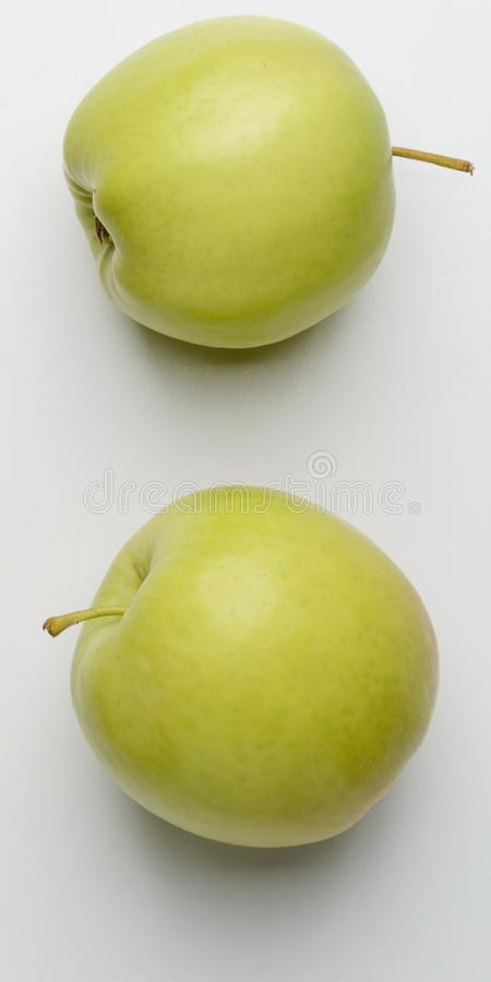 Two green apples on white. Background stock photos