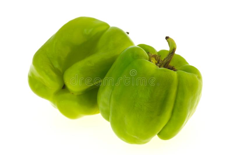 Two Green bell pepper isolated on white stock photo