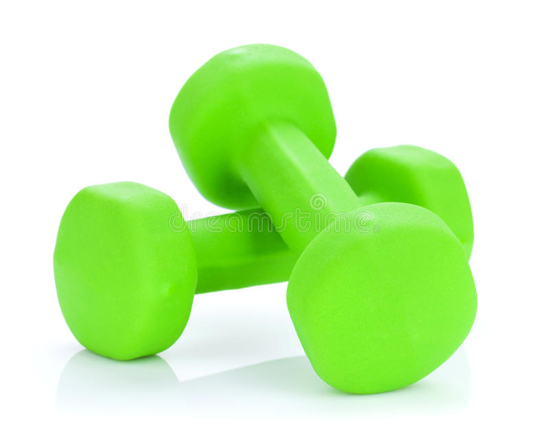 Two green dumbells. Isolated on white background stock images