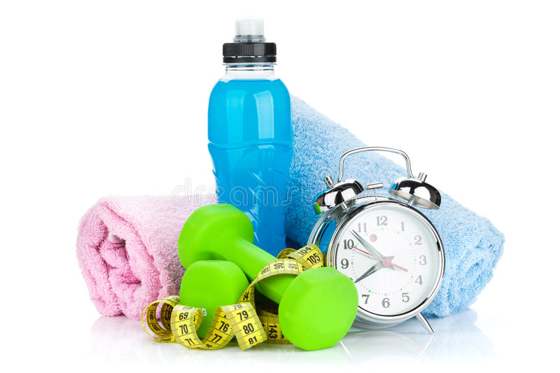 Two green dumbells, tape measure, drink bottle and alarm clock. Fitness and health. Isolated on white background stock photography