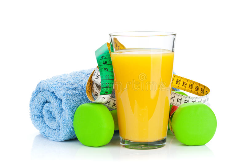 Two green dumbells, tape measure and orange juice. Fitness and h. Ealth. Isolated on white background royalty free stock images