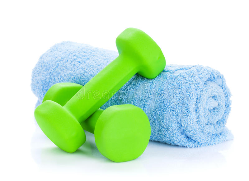 Two green dumbells and towel. Isolated on white background stock photography