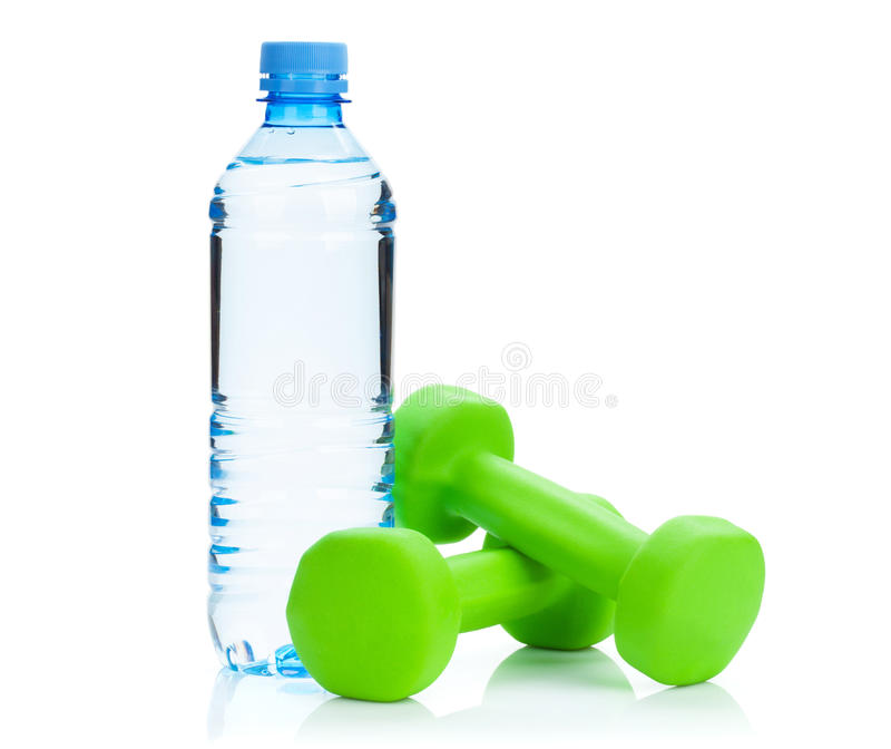 Two green dumbells and water bottle. Fitness and health. Isolated on white background stock photo