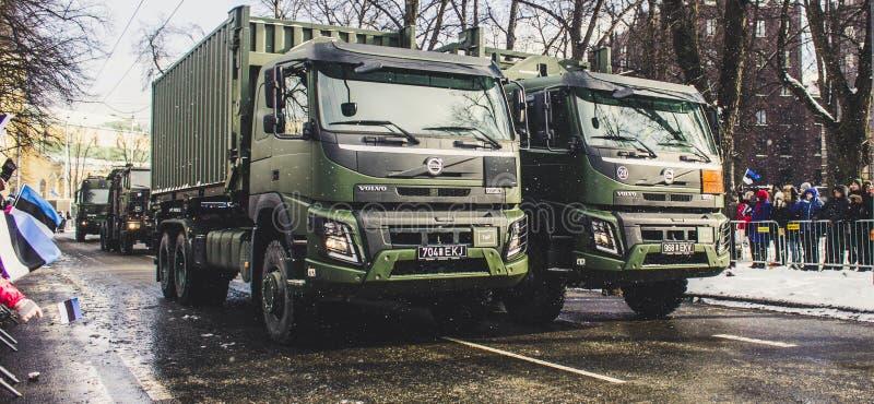 Two Green Dump Trucks On Gray Concrete Road