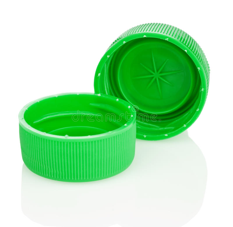 Two green plastic lids. Or bottle tops, isolated on white background royalty free stock image