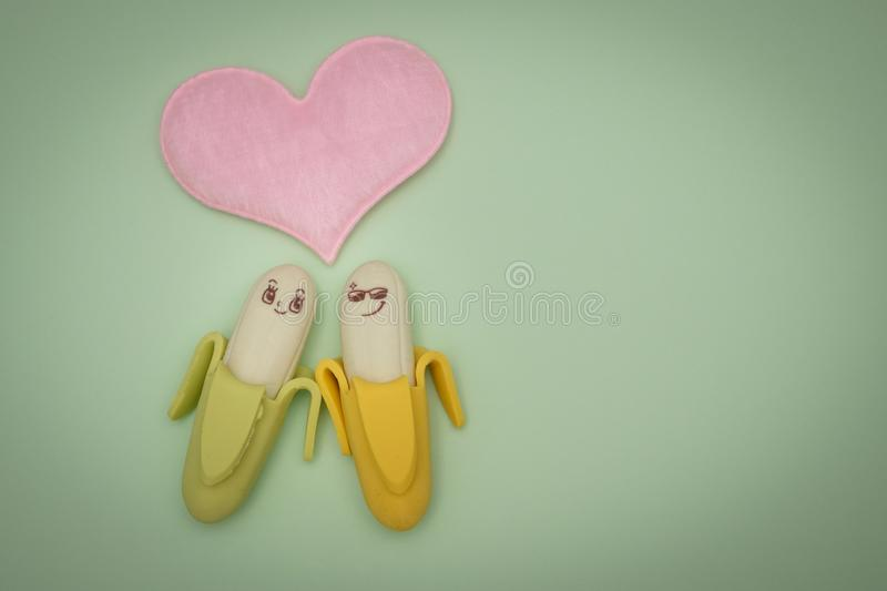 Two Green and Yellow Bananas Plastic Figures royalty free stock photos