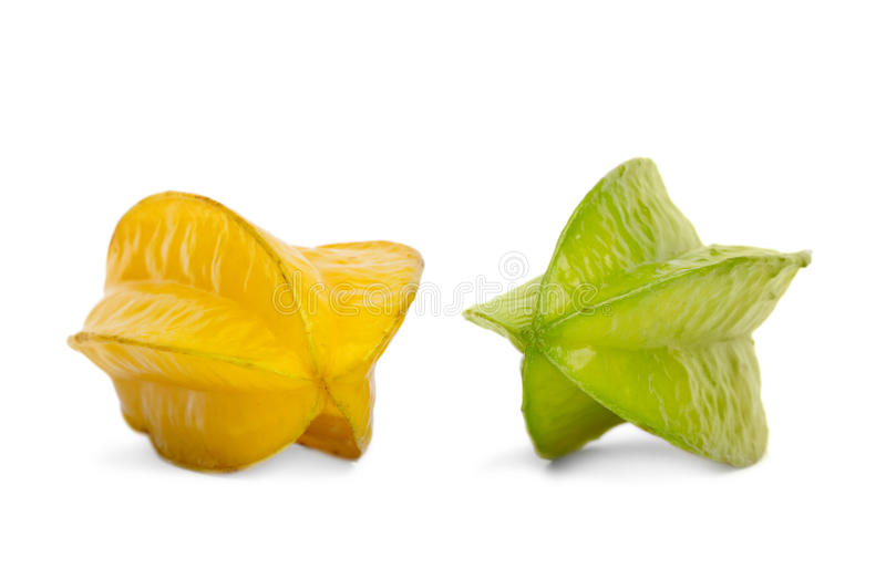 Two green and yellow carambolas. Sweet and healthy carambolas on a white background. Tasty fruit desserts for royalty free stock photo