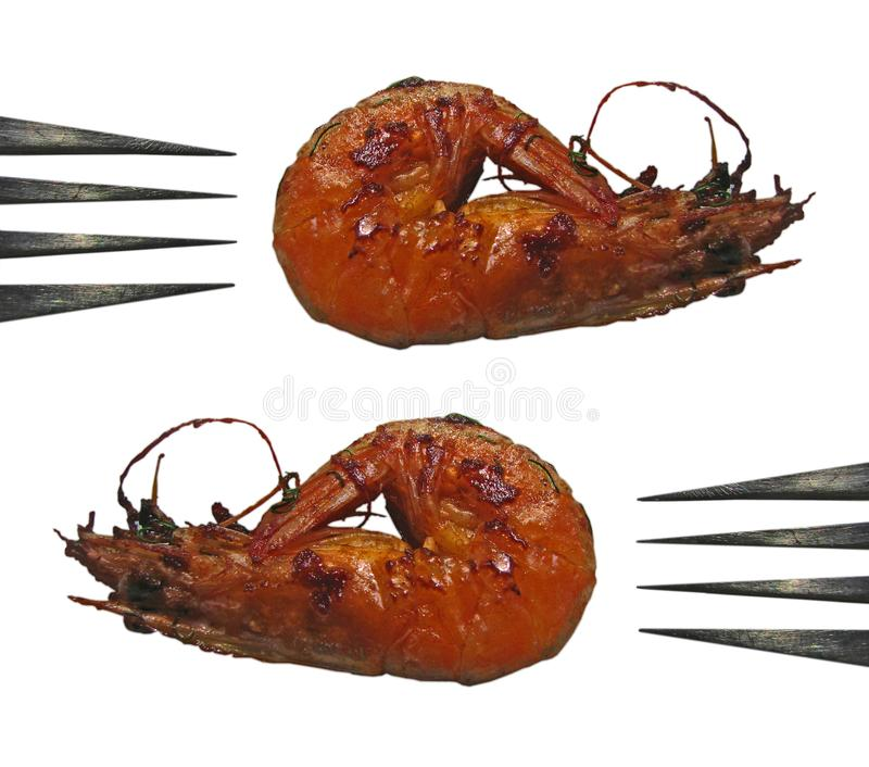 Two grilled shrimps and two forks close up fragments pattern stock photos