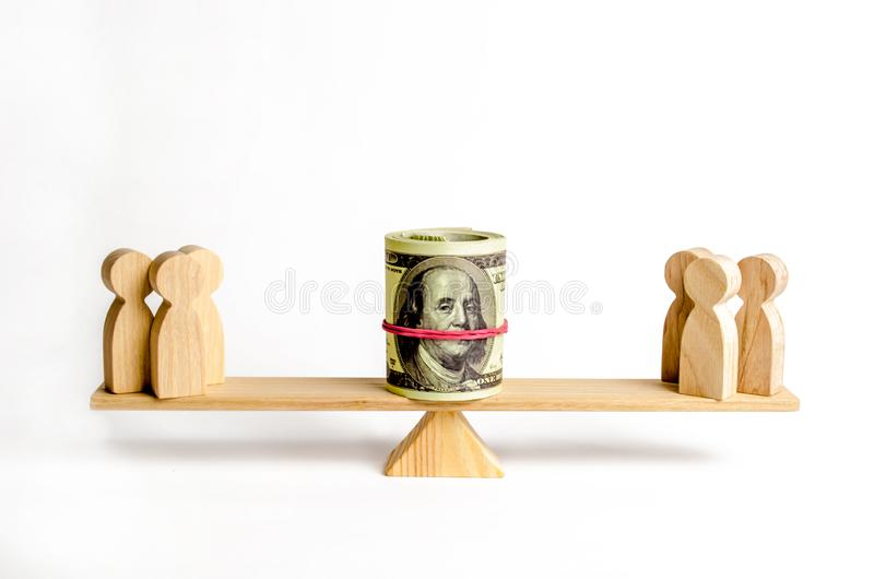 Two groups of people on the scales are suing for money. Conflict of interests and claims about debts or non-payment of funds. Reparation of damages and the royalty free stock images