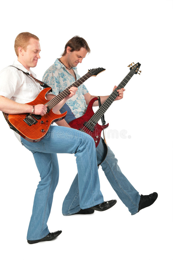 Two guitarists with leg up stock photography
