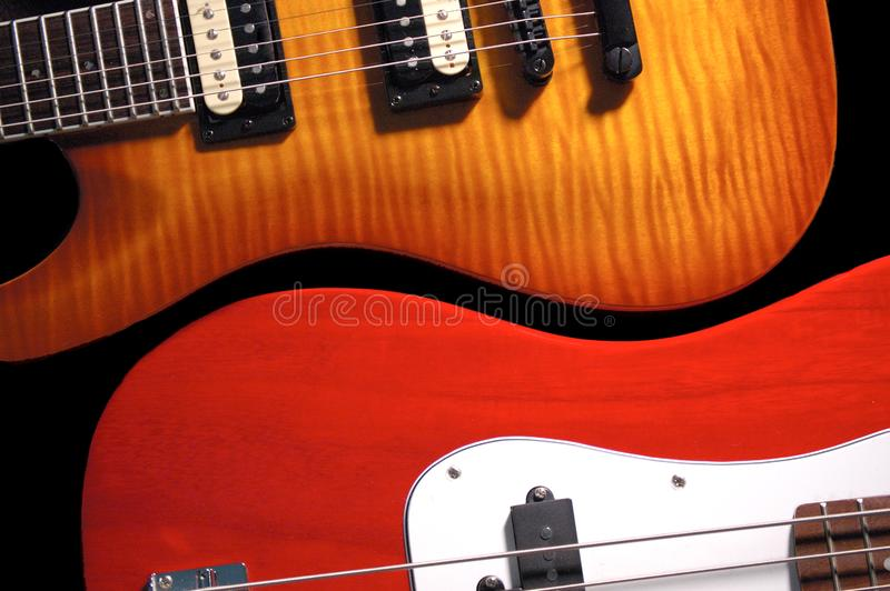 Two guitars side by side royalty free stock photos