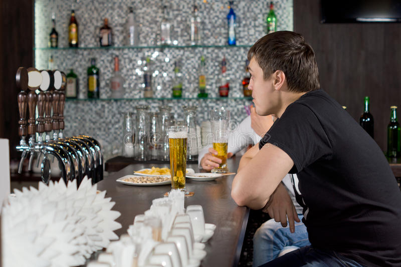 Download Two guys drinking at a bar stock image. Image of alcohol - 35256545