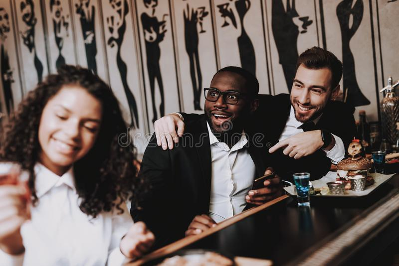 Two Guys. Girls. Bar. Drink Alcoholic Beverages. stock photography