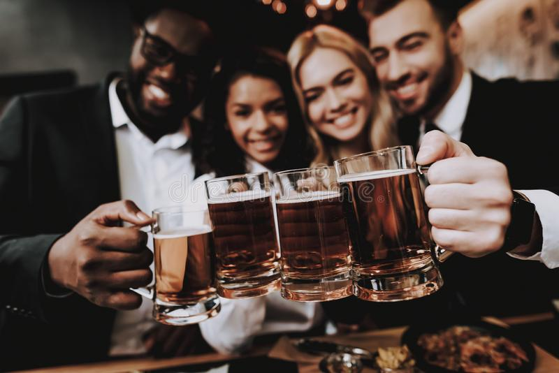 Two Guys. Girls. Chin-chin. Nightlife. Beer. Bar. royalty free stock photography