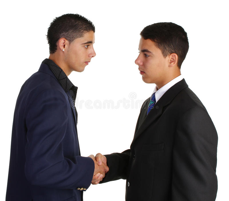 Two guys greeting. Each other and shaking hands royalty free stock photos