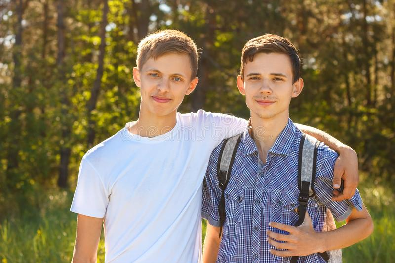 Smiling brothers hugging stock photo. Image of little