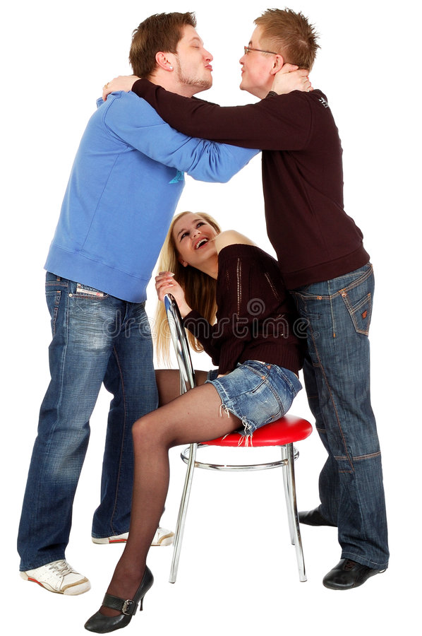 Two Guys Kissing In Front Of A Sitting Pretty Girl Royalty Free Stock Image