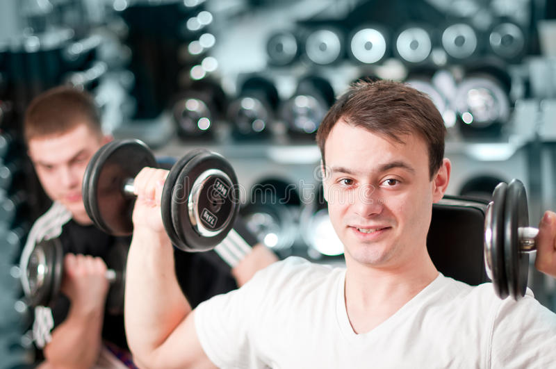 Two Guys Lifting Weight Stock Images