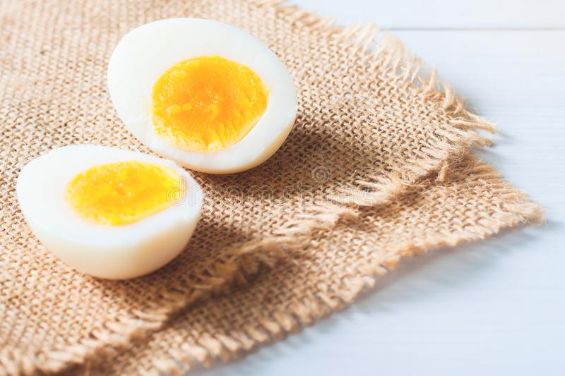 Two half of hard boiled egg on table, Healthy food, Nutrition co. Ncept stock photography