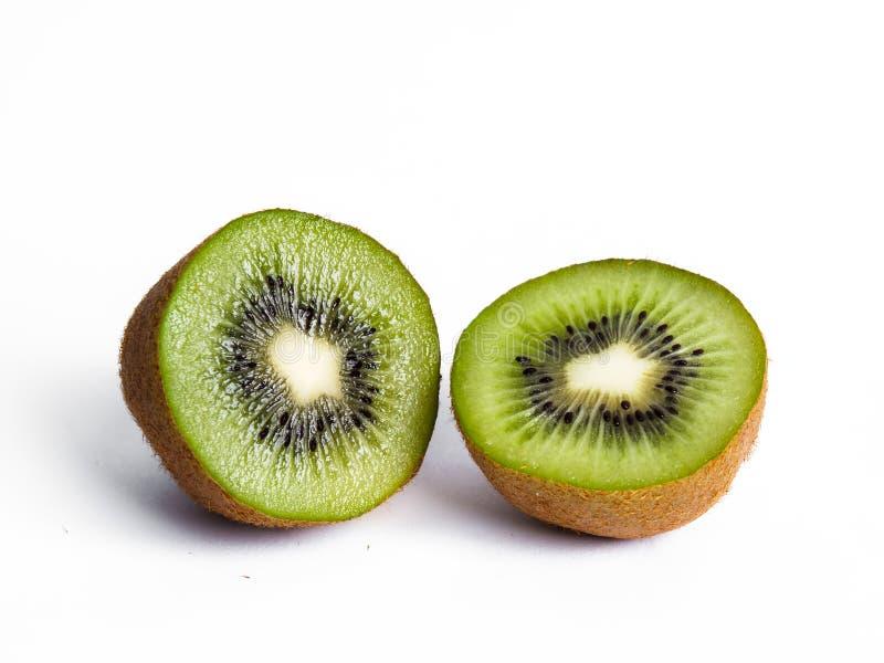 Two half Kiwis. A halfed kiwi fruit isolated on white background stock image