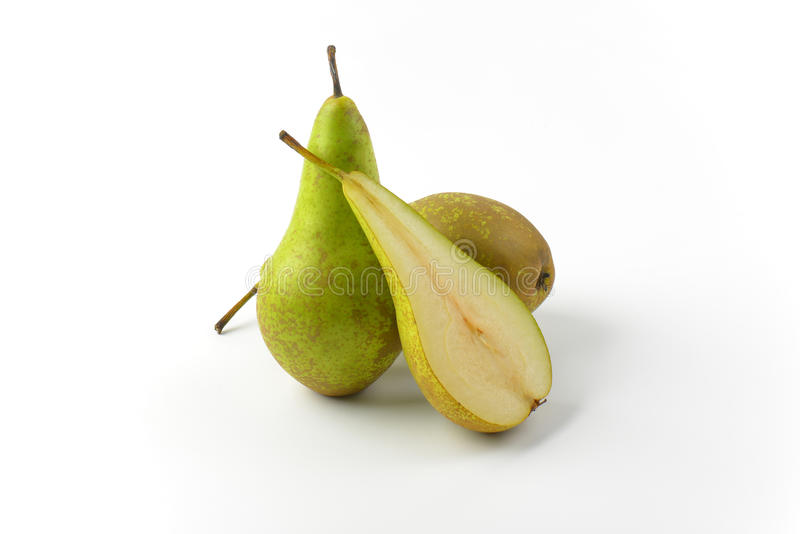 Two and a half pears. Two whole fresh green pears and one half stock photo