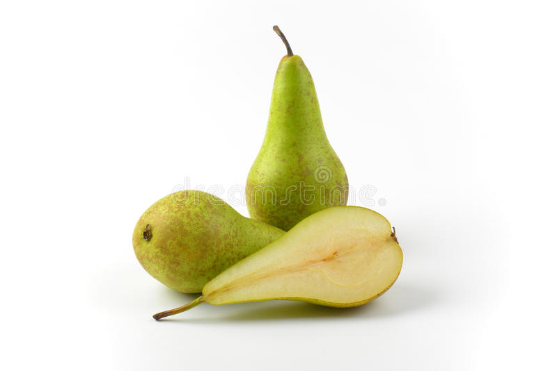 Two and a half pears. Two whole fresh green pears and one half stock photography