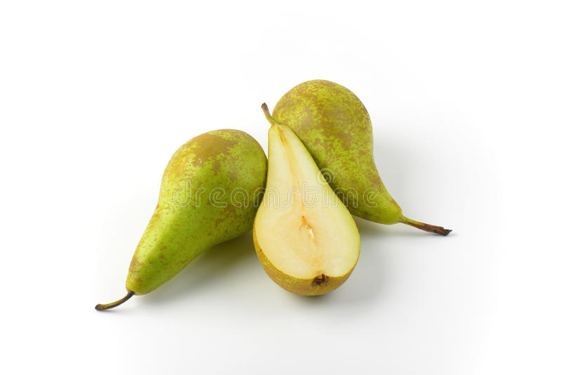 Two and a half pears. Two whole fresh green pears and one half royalty free stock image