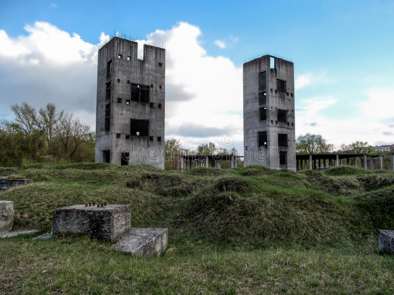 Two half-ruined towers in the wasteland stock photo