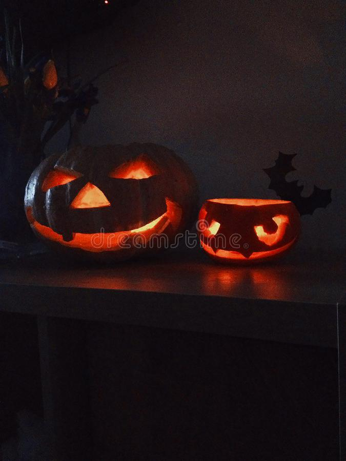 Two halloween pumpkins wiht light. In night royalty free stock photography