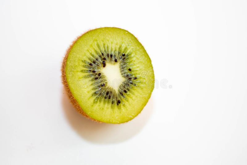 Two halves of one kiwi on a white background with soft shadow. royalty free stock photo