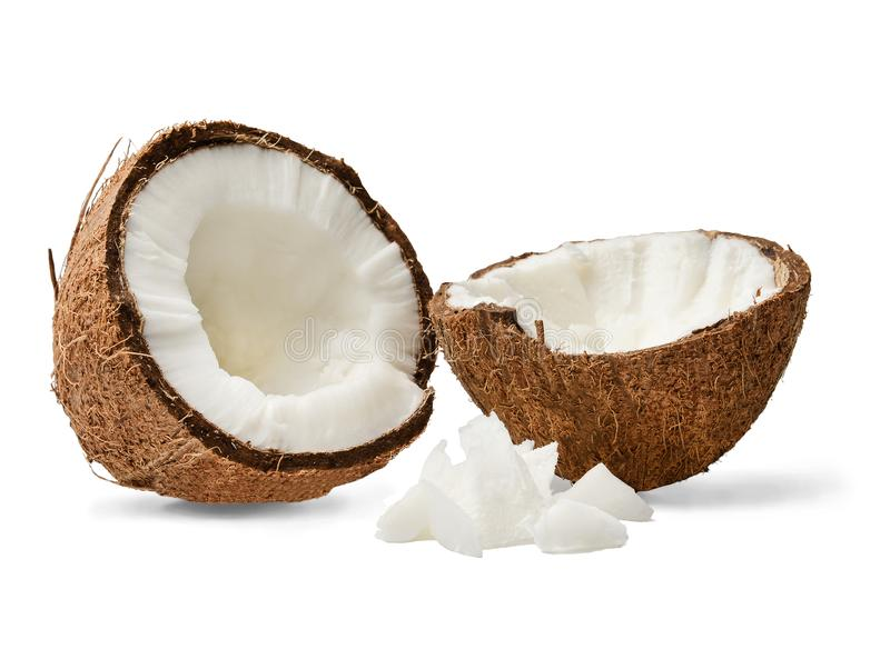 Two halves and pulp of chopped coconut. Close-up. White isolated background. royalty free stock photos