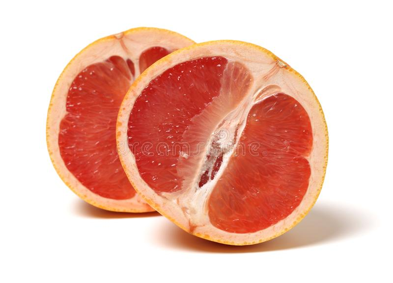 Two halves of red grapefruit stock image