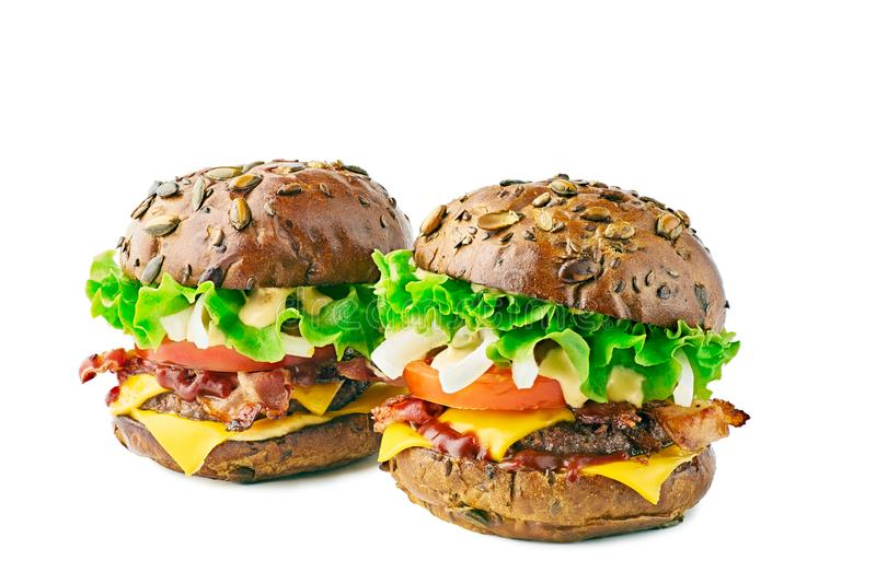 Two hamburgers with cereal buns on white background stock photo