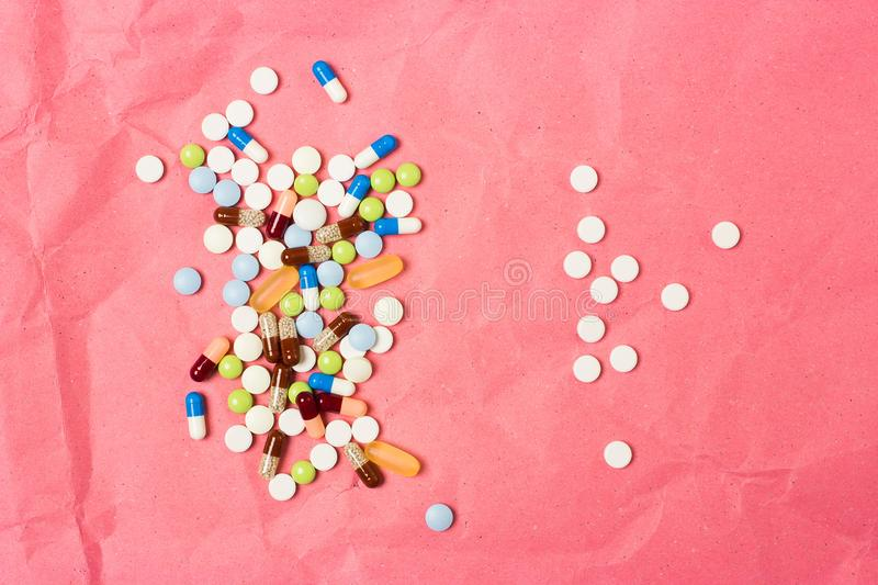 Two handfuls of scattered drugs, tablets and capsules stock photography