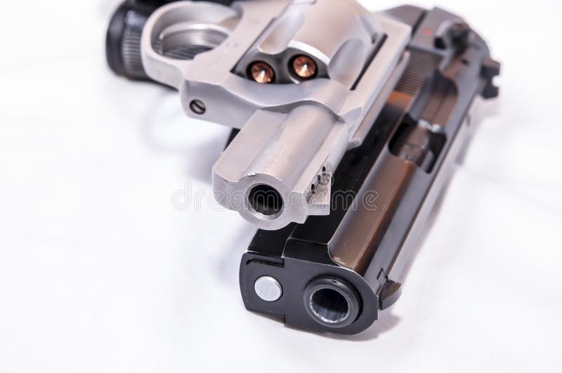 Two handguns, a 40 caliber pistol and a 357 magnum revolver. On a white background stock image