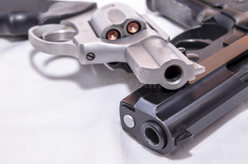 Two handguns, a 40 caliber pistol and a 357 magnum revolver. On a white background stock photography