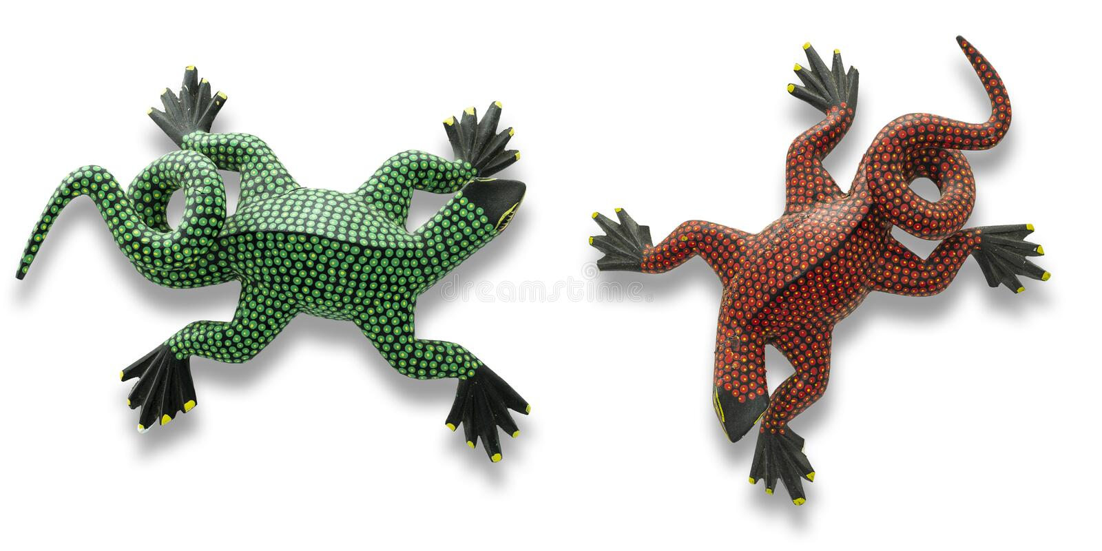 Two handmade Alebrijes in the state of Oaxaca on white background. Green and red alebrijes handmade crafts from San Martin Tilcajete in the state of Oaxaca royalty free stock image