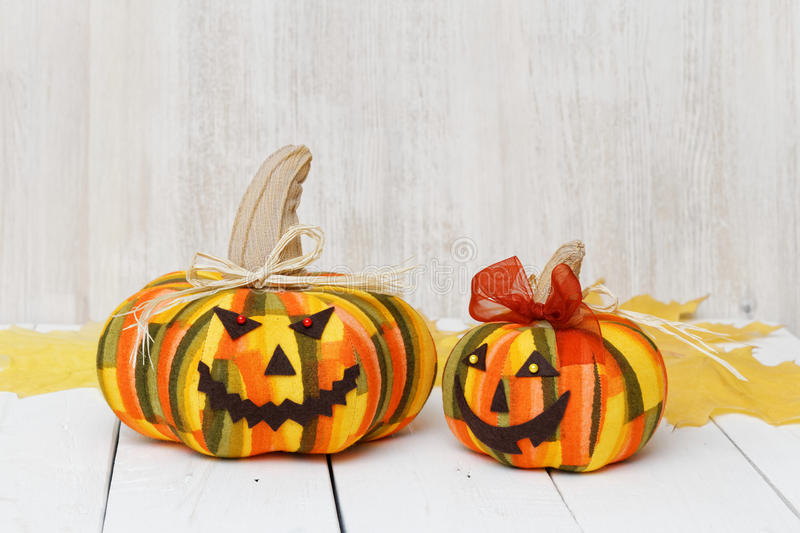 Two handmade smiling Halloween pumpkins stock photo