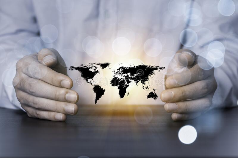 Two hands of businessman protecting world or global map. It is symbol of doing business with environmental conservation in mind. Two hands of businessman stock photos