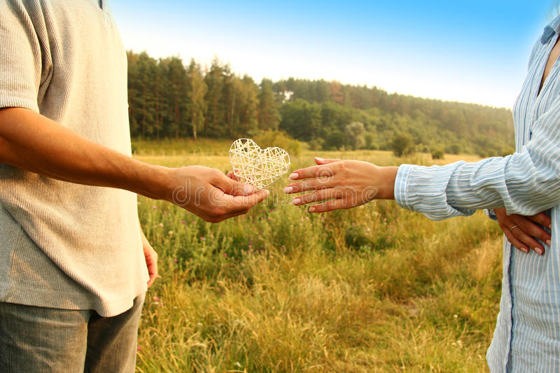 Two hands couple of love on nature stock photos