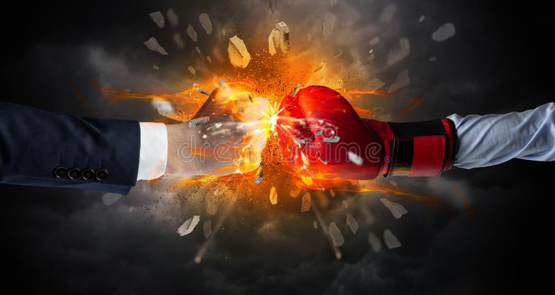 Fighting hands breaking rock. Two hands fighting and breaking a rock into small pieces royalty free stock photography